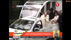 Pope Francis in the popemobile on his way to Manila Cathedral